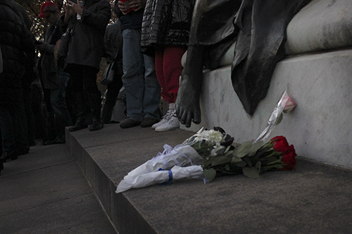 While some attendees held signs of support others carried red, white, and blue flower – the colors of the French tricolor – which they laid at the base of the Statue of the Marquis de Lafayette. Marquis de Lafayette, a French aristocrat and officer who fought in the Revolutionary War, is often viewed as a symbol of strength between the alliance of France and the United States. Paige James | Hatchet Photographer