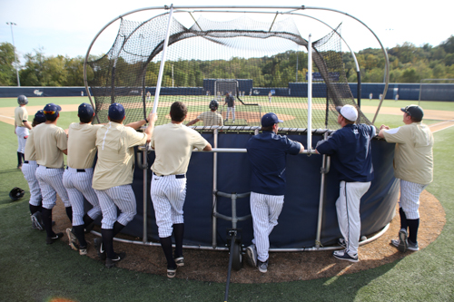 Many of the Colonials look on as one of their teammates takes batting practice in the fall. Dan Rich | Contributing Photo Editor