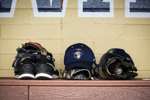 Hats, gloves and shoes line the Colonials' bench. Dan Rich | Contributing Photo Editor