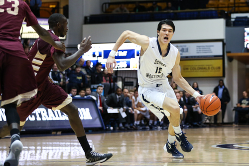 Sophomore Yuta Watanabe drives to the basket in the Colonials' win over Gannon earlier this season. File photo by Dan Rich | Contributing Photo Editor