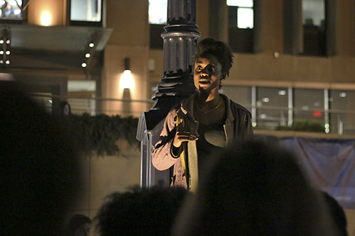 Sophomore Melissa Lawrence spoke in Kogan Plaza on Wednesday night, as participants gathered in solidarity with students at the University of Missouri. The system's president resigned this week after racial unrest on the campus.  Jordan McDonald | Hatchet Staff Photographer