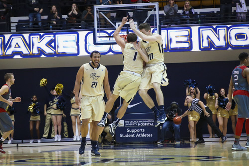 No. 1 Alex Mitola and No. 30 Matt Hart celebrate a three-point shot in the Colonials' win over Duquesne last Saturday. GW dropped a game that featured 19 lead changes Friday at Dayton. Dan Rich | Contributing Photo Editor