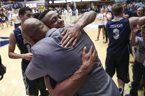 Senior guard Joe McDonald hugs Associate Head Coach Hajj Turner after the Colonials defeated florida. GW will head to Madison Square Garden on Tuesday for the semifinals. Dan Rich   Contributing Photo Editor