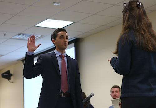 Junior Thomas Falcigno is sworn in as executive vice president Monday night. Jordan McDonald | Hatchet Staff Photographer