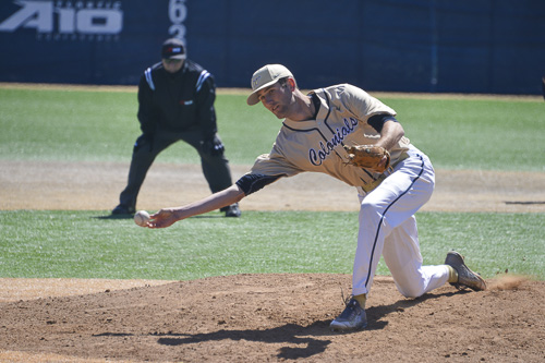 Senior Luke Olson releases a pitch to a La Salle hitter last week. Olson and the Colonials are trying to piece together a relieving corps despite a host of injuries. Hatchet File Photo.