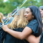 A new bid to Chi Omega hugs a sister during Bid Day on the National Mall.  Isabella Brodt | Hatchet Photographer