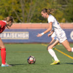 Senior MacKenzie Cowley dribbles the ball around a Richmond defender during the women's soccer game on Sunday. Cowley scored her team-high ninth goal of the season against the Spiders. Sam Hardgrove   Assistant Photo Editor