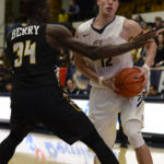 Junior guard Yuta Watanabe drives against a UAPB defender earlier this season. After two road losses, Watanabe and the Colonials return home Saturday to take on Penn State. Madeleine Cook | Hatchet Photographer
