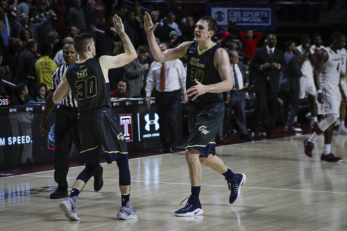 Graduate student forward Tyler Cavanaugh celebrates GW's 66-63 win at Temple Wednesday night after hitting a game-winning three. Ethan Stoler | Hatchet Photographer