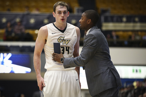 Interim head coach Maurice Joseph talks to Tyler Cavanaugh during GW's win over USF on Dec. 3. Cavanaugh led GW with 22 points against Richmond Sunday as the Colonials fell 77-70. Dan Rich | Photo Editor