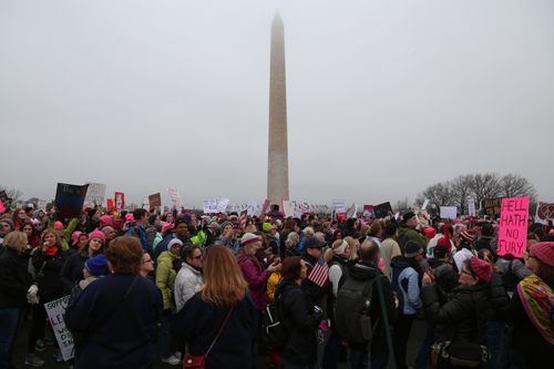 Protestors march past the Washington Monument on their way to the White House. Olivia Anderson | Contributing Photo Editor